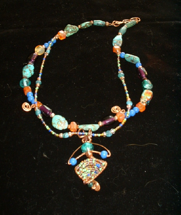 Bonnie Mincu's seed bead pendant with turquoise, blue and copper