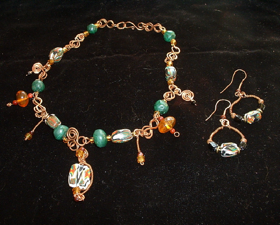 Bonnie Mincu's copper wire with amber, green and black pendant choker