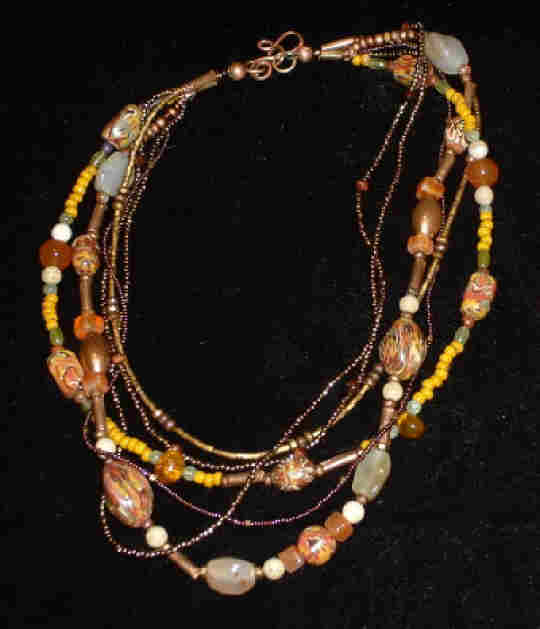 Bonnie Mincu's yellow ethnic multi-strand necklace for Dale